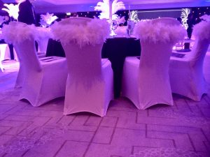 filling your space feather boas on chair covers